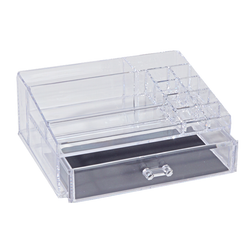 The organizer has multiple compartments with a drawer. Crystal clear acrylic to mimic glass.