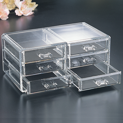 The beautiful and sleek crystal clear acrylic makes your jewelry easily visible. It has 6 drawers.