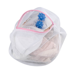 Lingerie Wash Bag and Ball filled with laundry.