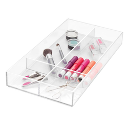 It features four compartments and is made of crystal-clear, durable, acrylic, so everything is visible as well as accessible.