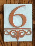 "GRANDE NUMBER TILE  This is a grande and beautiful tile.  It is 6h x 8w x 1/2"" thick. It is shown in a standard off-white glaze with exposed terracotta numbers and design flourish.  Size will vary slightly with drying and kiln firing."