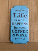 Life Is What Happens Between Coffee and Wine Primitive Distressed Wood Sign. Size 14x7. Blue background with black text.