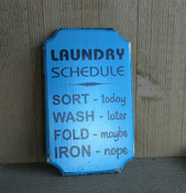 Laundry Schedule. Distressed look with blue background and black text. Size 12x7. Comes with a picture hanger in the rear.