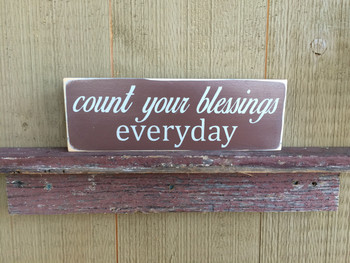 Count Your Blessings. Distressed. Brown with white text. Size 4 x 12.