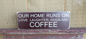 Our House Runs On Love, Laughter and Coffee. Distressed. Brown with white text. Size 4x12.
