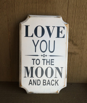 Love You To The Moon and Back.  Distressed.  White background with black text. Size 12x7. Comes with a rear picture hanger.