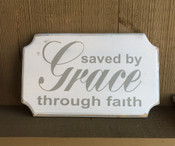 Saved By Grace Through Faith. Distressed. White background with gray text.  Size 12x7.  Comes with a rear picture hanger.