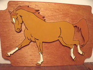 CANTERING WOODEN PAINTED HORSE MOUNTED ON WOOD