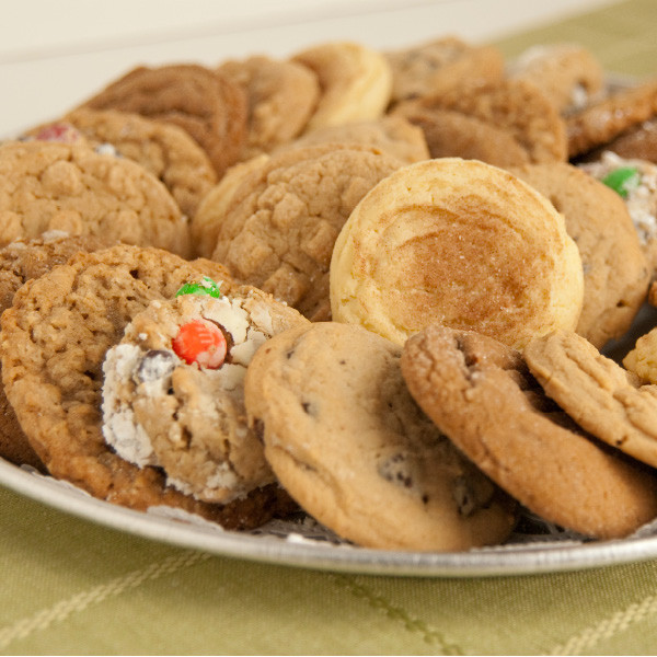 No time to bake for your party or family gathering? Let our experienced Amish bakers help you! Our homemade cookie trays are assembled, carefully wrapped and ready to serve. You can even freeze them for later use. Available in assorted trays with chocolate chip, molasses, snickerdoodle, oatmeal, peanut butter and monster cookies.  Cookies are approximately 3 inches in diameter.
