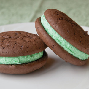 Who wouldn't love to receive these delicious whoopie pies for St. Paddy's Day? From our creative Amish bakers, two moist chocolate cake cookies are sandwiched around filling flavored with Andes Mint candy. Comes in one dozen jumbo-sized whoopie pies. Homemade in Ohio's Amish Country.   Each sandwich cookie is approximately 4 inches in diameter.