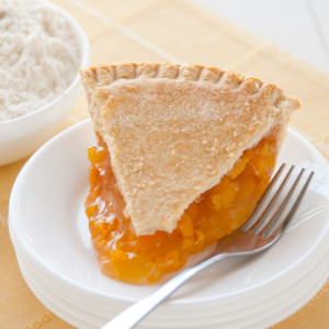 Juicy golden peaches are cooked perfectly in a blonde filling with a delicious result. Our double-crusted fruit pies are lightly brushed with butter and sprinkled with sugar to brown the crust. Pies will arrive pre-baked and frozen in an insulated shipping cooler. Simply thaw in the oven and your home will be filled with the sweet scent of our Amish bakery. Instructions are included.  Available as 9 inch pie. Baked and shipped from Ohio's Amish Country.