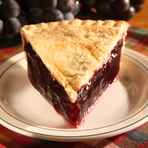 An annual fall favorite, try out our delicious grape pie from our bakery in Sugarcreek. We use whole black grapes and Concord grape juice to make this uniquely Amish country pie.  Our experienced Amish bakers create the light crust and old-fashioned fillings that are typical of Amish pies. Our double-crusted fruit pies are lightly brushed with butter and sprinkled with sugar to brown the crust. The pies will arrive pre-baked and frozen–simply thaw in the oven and your home will be filled with the sweet scent of our Amish bakery.  Available in a 9 in diameter pie. Amish Pies are made in Ohio's Amish Country.