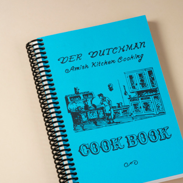 "The cooks of the famed Der Dutchman Restaurant in Walnut Creek, Ohio, know exactly how to put the comfort in comfort food. First published in 1973, this classic cookbook contains fun surprises like ""Never-fail Pie Crust"", ""Bushel Cookies"", ""Poor Man's Steak"", and ""Old-fashioned Butterscotch Pie."" Along with traditional recipes destined to become dog-eared favorites, you'll find original Pennsylvania Dutch jingles in every chapter.  180 pages. A great stuffer for your Amish Gift Baskets!"