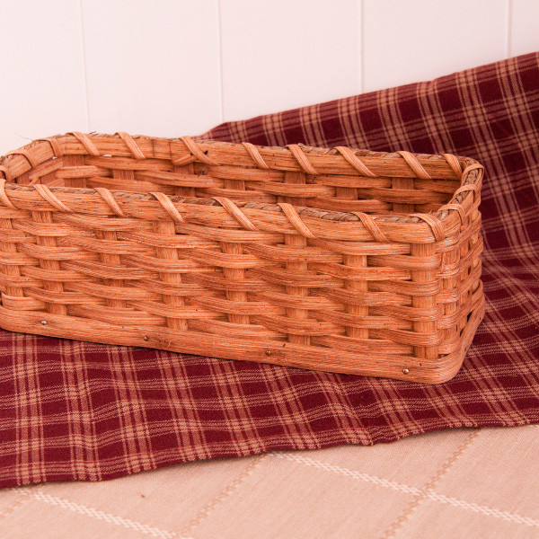 When you visit Amish Country, it's common to see reed baskets sold in simple stands at the roadside. They are sturdy, well-made and intended to last. Each Cracker Basket is signed and dated by the Miller family from Maysville, Ohio.  Made specially for Dutchman Online Store, our custom-made authentic Cracker Basket is approximately 10 inches long, 3.5 inches wide and 3.5 inches high.