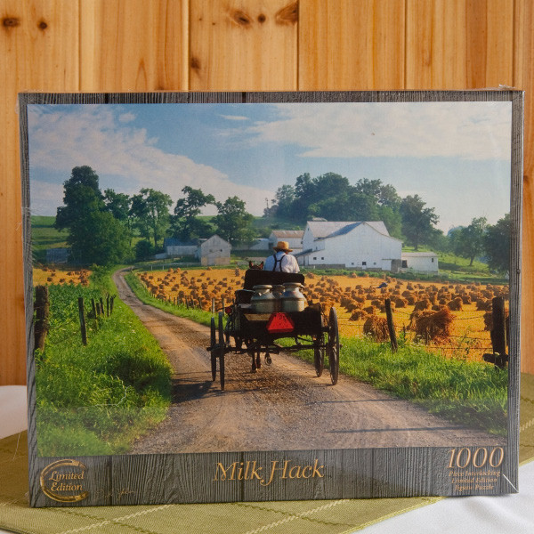 """Go along with an Amishman as he hauls his day's milk to be made into cheese at Guggisberg Cheese, near Berlin, Ohio. Adults and children 12 and up will enjoy collaborating on their recreation of a gorgeous Doyle Yoder """"Milk Hack"""" photo. The finished family masterpiece will measure 20 inch x 27 inches."""