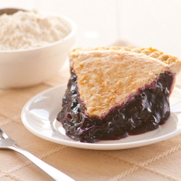 Our Classic Blueberry Pie is filled with plump, ripe blueberries in a thick flavorful filling then baked in our homemade pie crusts. No artificial flavorings and colorings are used. Our double-crusted fruit pies are lightly brushed with butter and sprinkled with sugar to brown the crust.  Pies will arrive pre-baked and frozen in an insulated shipping cooler. Simply thaw in the oven and your home will be filled with the sweet scent of our Amish bakery. Instructions are included. 9 inch pie. Homemade Amish Pie made in Ohio's Amish Country.