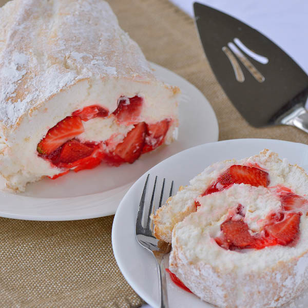 A seasonal variation on an Amish country classic, our fresh strawberry cake rolls are made with a layer of pillowy-soft homemade angel food cake and filled with our fresh strawberry pie filling and light fluffy cream cheese. Our fresh strawberry pie filling is made with juicy uncooked fresh strawberries in a homemade glaze.  The entire cake is rolled together in a 24oz cake roll and dusted with powdered sugar.