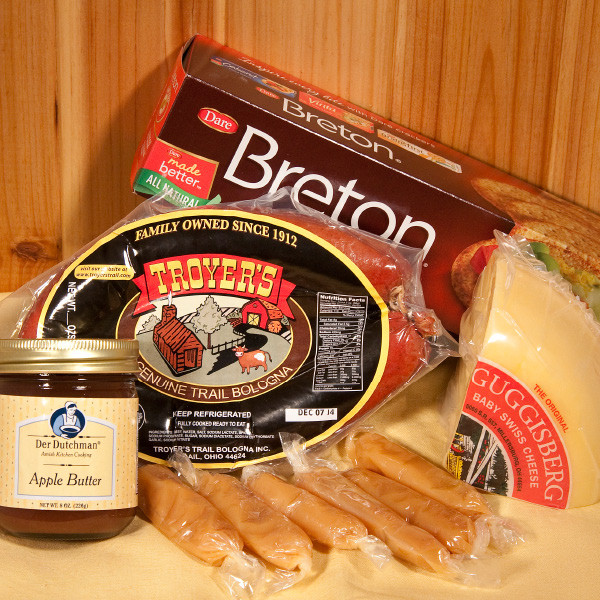 Your Favorites Box contains Amish Country Favorites such as Troyers Trail Bologna, Guggisberg Baby Swiss cheese, Hartmans' Caramels, Der Dutchman Apple Butter and Breton Crackers.