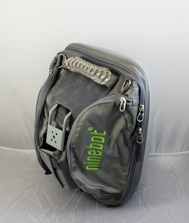Ninebot Cargo (Storage) Bag.  This view is the back right side.  You can see the mounting hardware (included) hanging in the center.  Also visible is one of two large exterior storage pouches.  There's one on the right side and one on the left.  There's also a very durable handle at the top for when you need to carry the bag by hand.