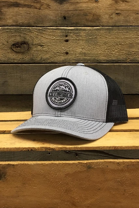 Deep River Round Patch on heather grey with black mesh Richardson Hat with cotton polyester front panels and visor, with nylon mesh back panels.