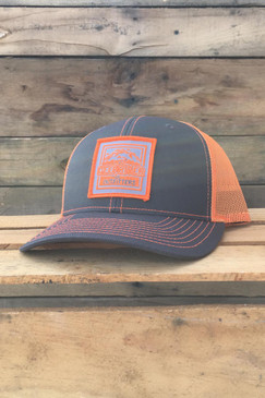 Deep River Square Patch on charcoal with neon orange mesh Richardson Hat with cotton polyester front panels and visor, with nylon mesh back panels.