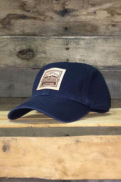 Deep River Leather Square Patch on solid navy heavy weight chino twill Richardson hat with garment washing; relaxed contoured crown shape.