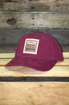 Deep River Leather Square Patch on solid cardinal brushed chino twill Richardson hat with low-profile structured crown, buckram-fused front panels and ProStitching.