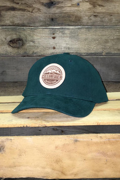 Deep River Leather Round Patch on solid dark green brushed chino twill Richardson hat with low-profile structured crown, buckram-fused front panels and ProStitching.