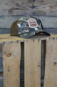 Deep River Leather Arch Patch on Realtree Max5 Camo with buck mesh Richardson Hat with cotton polyester front panels and visor, with nylon mesh back panels.