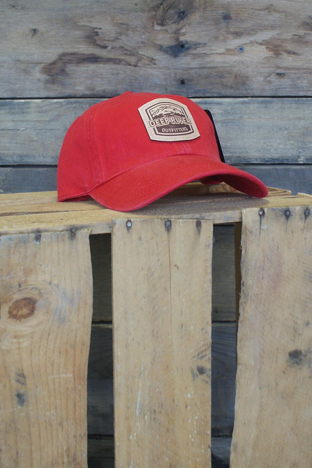 Deep River Leather Arch Patch on solid red heavy weight chino twill Richardson hat with garment washing; relaxed contoured crown shape.