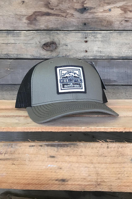 Deep River Square Patch on loden with black mesh Richardson Hat with cotton polyester front panels and visor, with nylon mesh back panels.