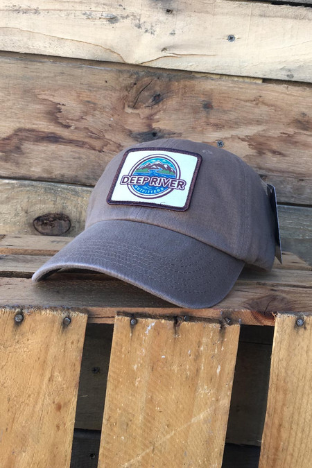 Deep River Sublimated Patch on solid driftwood heavy weight chino twill Richardson hat with garment washing; relaxed contoured crown shape. Hideaway backstrap with metal comfort buckle provides perfect one size fits most fit.