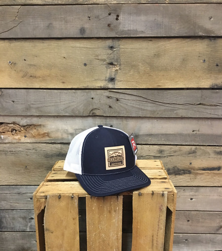 Deep River Leather Square Patch on Navy with White mesh Richardson Hat with cotton polyester front panels and visor, with nylon mesh back panels.