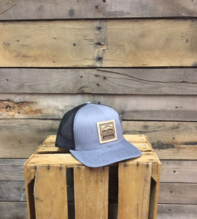 Deep River Leather Square Patch on Heather Grey with Black mesh Richardson Hat with cotton polyester front panels and visor, with nylon mesh back panels.