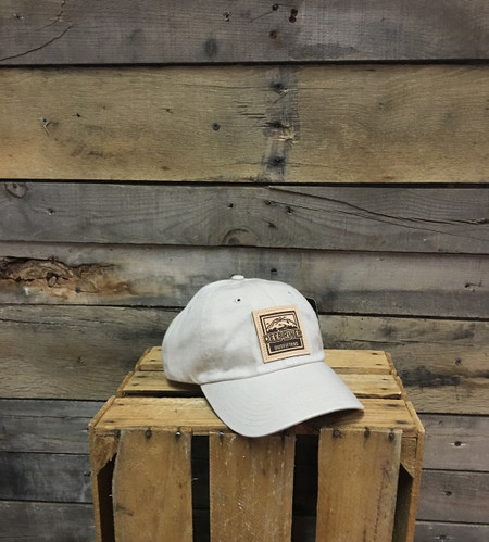 Deep River Leather Square Patch on solid Khaki heavy weight chino twill Richardson hat with garment washing; relaxed contoured crown shape.