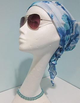 hair-covering-style-a-aqua-floral-on-headform.jpg