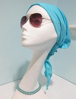 hair-covering-style-a-in-aqua-on-headform.jpg