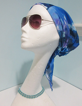 hair-covering-style-a-in-lilac-floral-on-headform.jpg