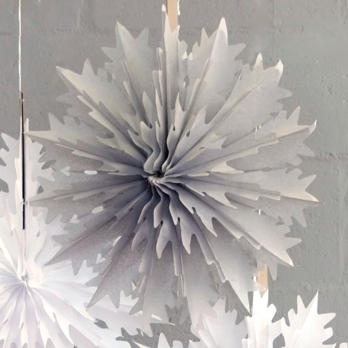 Intricate grey snowflake Christmas decoration for parties and home celebrations