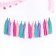 Tissue paper tassel garland party decoration for unicorn themed birthday parties and children's bedroom interior decor