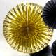 Sparkly gold metallic fan decoration