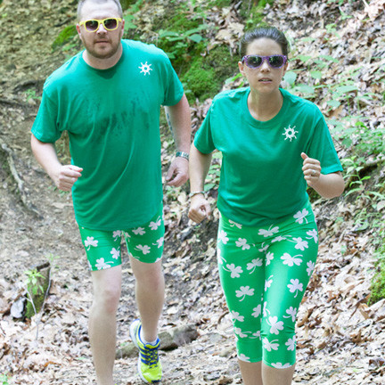 "Special 8"" shorts in our shamrock print. White four leaf clovers on green background."