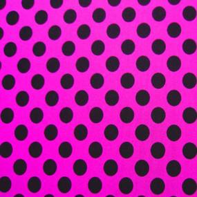 Hot pink fabric with black polka dots