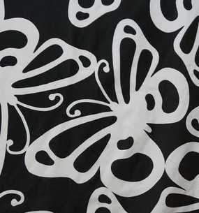 Black fabric with large white butterflies