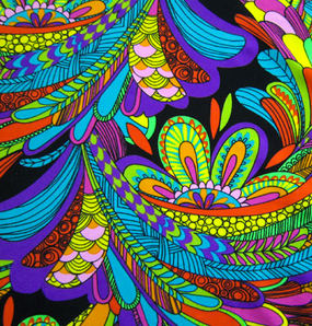 Vegas Fabric. A mix between colorful paisley and peacock pattern. Predominantly blue, purple and lime green.