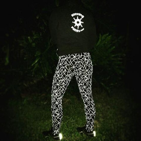 Shown at night with reflective pattern. Tights shown but this pattern is available in Tights, Capris, Shorts, and arm sleeves.