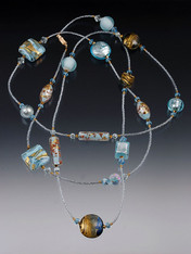 """A Venetian sky filled with soft clouds is yours to wrap around your neck as often as you like with this spectacular rope featuring 24K flecked celestial blue Venetian glass, 24K  Swarovski crystals, and 14K clasp. No two alike!All components custom-designed and imported from Italy! Choose 44"""" or 64"""