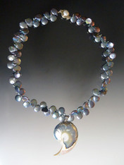 This delightful necklace features peacock coin pearls with an unusual blue and white one-of-a-kind Nautilus Shell Pendant. 18""