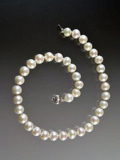 If you crave Mikimoto pearls but can't afford to walk in the door, these pearls are extraordinary for the price.  Totally classic silk-hand-knotted extremely well matched 14mm round white pearls with a white gold clasp.  17-1/2""