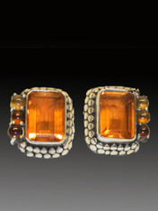 """These colorful vivid Amy Kahn Russell earrings feature a faeted whiskey quartz cabochons, set in an intricately patterned sterling silver dotted frame with citrine, tourmaline, and carnelian cabochons on one side. 1"""" x 1/2"""" Now posts; convert to clips for $15"""